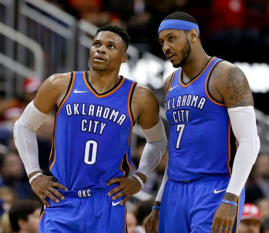 In this Saturday, April 7, 2018 file photo, Oklahoma City Thunder guard Russell Westbrook (0) and forward Carmelo Anthony (7) talk during the second half of the team's NBA basketball game against the Houston Rockets in Houston. Anthony has been the No. 1 option for whatever team he has played on during most of his basketball career. He knew that wasn't going to be the case when he arrived in Oklahoma City, though it's safe to say things haven't gone as he expected when he signed up to be part the league's next Big Three. (AP Photo/Michael Wyke, File)