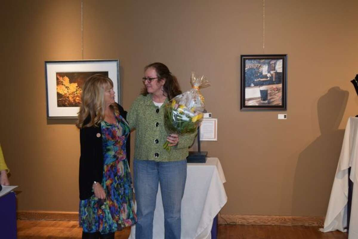 Artworks Executive Director Lynne Scheible (left) presents a surprised Ruth Vermeer with the Patron of the Arts Award for 2018 during the Bevy of Brew Hues reception on April 5. (Courtesy photo)
