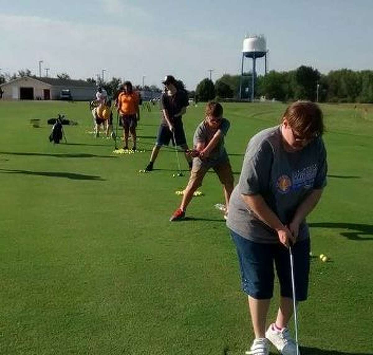 Athletes from Area 5 Special Olympics Michigan practice golfing at Katke Golf Course in Big Rapids. The athletes will be competing Sept. 29 to Oct. 1 in the Special Olympics Michigan State Fall games. (Courtesy photo)