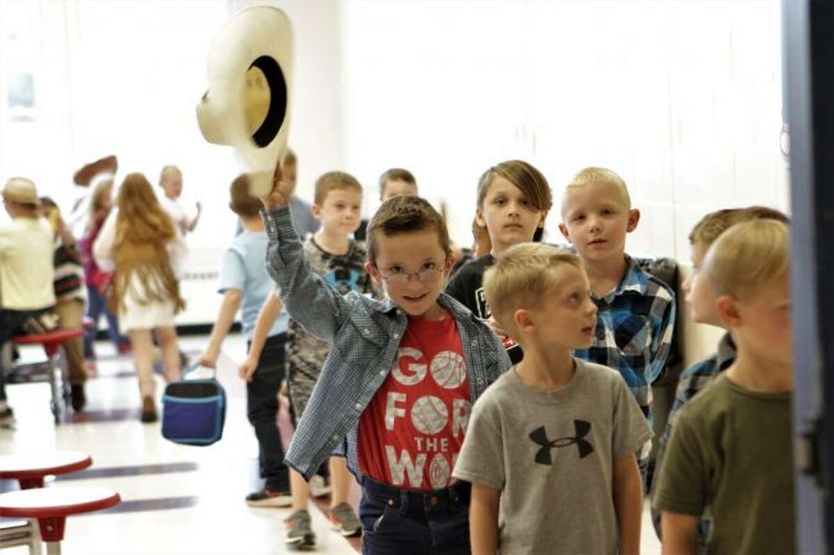As G.T. Norman Elementary students finish their lunch on Country/Western Day, a youth stops to tip his hat for a photo. The dress-up day is one of the many planned through the week leading up to homecoming on Friday. (Pioneer photos/Meghan Gunther-Haas)