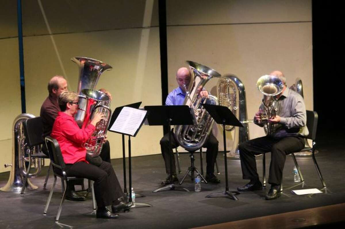 Tuba players Phil Sinder, Michigan State University professor, and Charles Guy, a professor at Crane School of Music in Potsdam, N.Y., as well as euphonium players Gail Robertson, University of Arkansas professor, and Ed Mallett, of Tuba Bach, play during Sunday afternoon's Tuba Bach Quartet concert, as part of the annual music series. The concert included some songs more recognized for stringed instruments rather than tubas. The series continues on Saturday, Sept. 30, with the theme