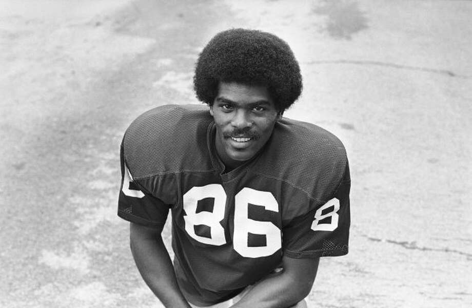 This Aug. 1975 file photo shows St. Louis Cardinals wide receiver Marlin Briscoe. The Pro Football Hall of Fame calls Briscoe, an Omaha, Neb. native, the first black quarterback in the modern era of pro football. He opened the door for many, including Carolina's Cam Newton and Seattle's Russell Wilson, who both pay homage to him. (AP Photo/File)