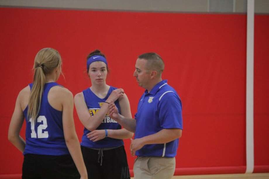 Evart girls basketball coach Matt Tiedt works with his players during the Ferris State camp on Friday. (Pioneer photo/John Raffel)