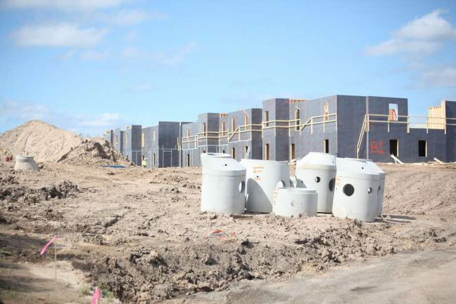 Construction on Eight Thirty Water Tower apartments, owned by Spectra Student Living, began in July, and the complex is expected to be completed in August 2019. The apartments are located on Water Tower Road next to Super 8 by Wyndham Big Rapids and Department of Human Services. (Pioneer photo/Taylor Fussman)