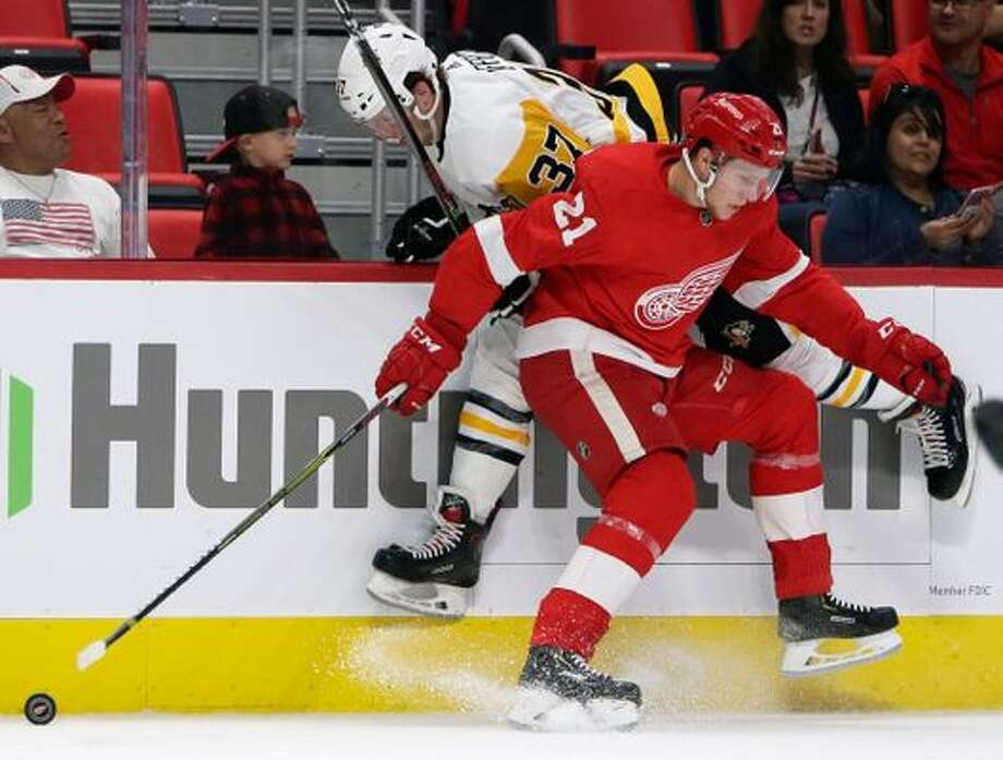 Pittsburgh Penguins center Sam Lafferty (37) is checked against the boards by Detroit Red Wings defenseman Dennis Cholowski (21) during the first period of a preseason NHL hockey game, Wednesday, Sept. 19, 2018, in Detroit. (Photo: Duane Burleson, AP)
