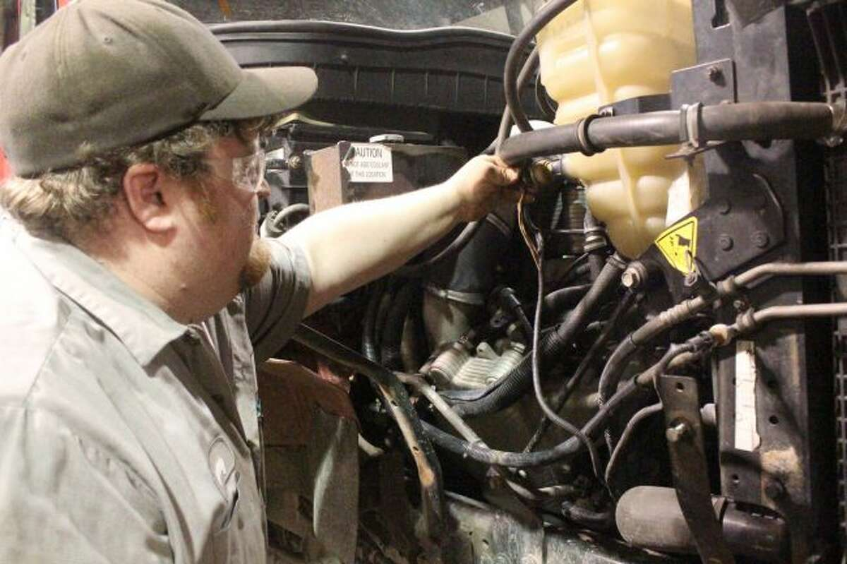 Mecosta County Road Commission mechanics work on one of the trucks in April. Officials and crews in Mecosta County are ready for whatever comes up this winter. (Pioneer file photo)