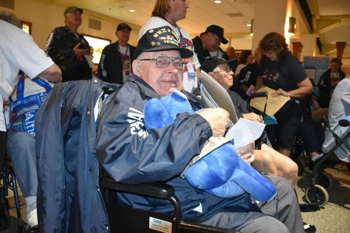 This veteran shows off the teddy bear he received from Project Hero Hugs by the Mecosta County Blue Star Mothers, who delivered bears to those returning from a Mid-Michigan Honor Flight to Washington, D.C. (Courtesy Photo)