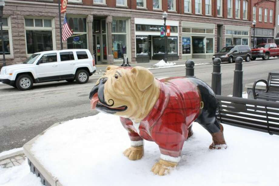 Taking a family picture with a bulldog statue will be one of the items on a list for participants in a free family scavenger hunt in Big Rapids on Saturday. Evart participants will get a different list. (Pioneer photo/Candy Allan)