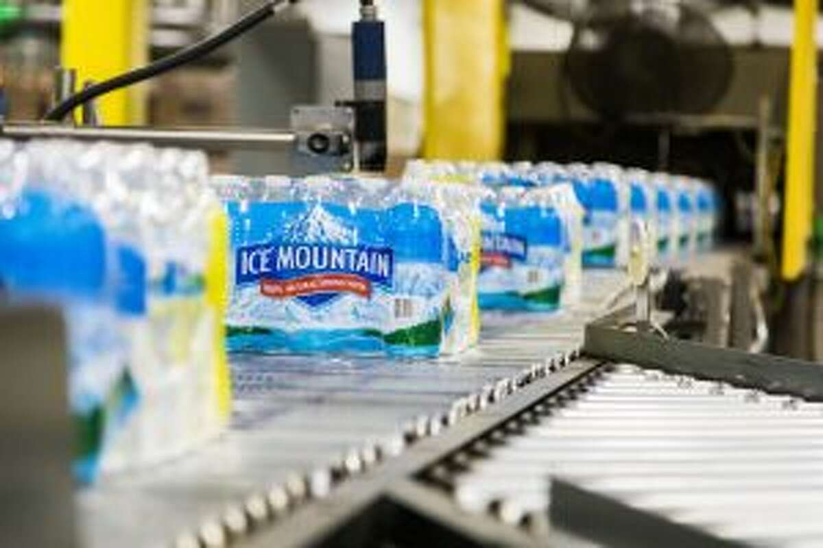 In this Pioneer file photo, bottles of Ice Mountain Spring Water are seen on the production line at the bottling facility. Water from Nestlé Waters North America's White Pine Springs well in Osceola Township is bottled at the facility. The Michigan Citizens for Water Conservation group has challenged the Michigan Department of Environmental Quality about approving NWNA's request to increase its withdrawal capacity at the well, from 250 gallons per minute to 400 gallons per minute. (Pioneer file photo)