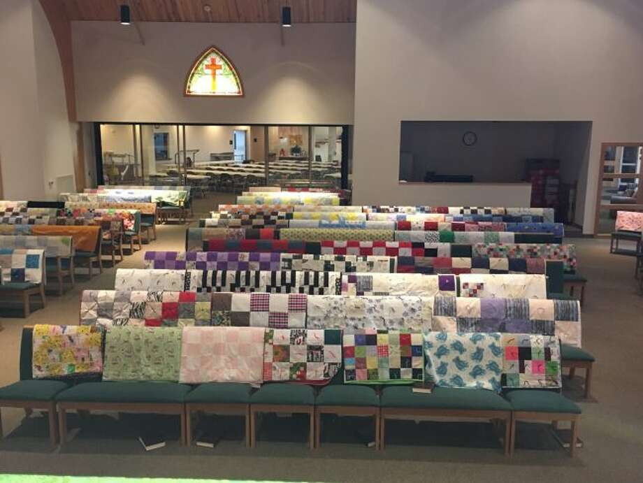 The 131 quilts made by the Lutheran Women's Missionary League at Trinity Lutheran Church and School are shown draped over every pew in the sanctuary. The LWML makes the quilts and donates to local and national organizations. (Courtesy Photo)