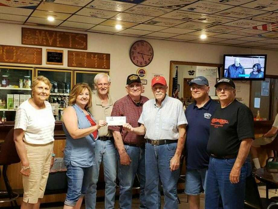 Members of the River Valley Car Club of Big Rapids presented Dan Oleson of the AMVETS Post No. 1941 with a donation of funds received through the car club's Memorial Day car show. The check was presented to the organization on Thursday, June 27. (Courtesy photo)