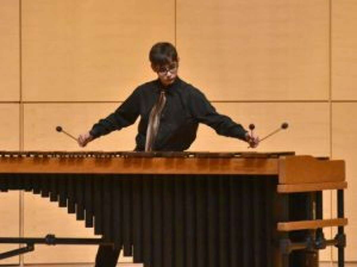 MOVING AND GROOVING: Noah Mallett, of Crossroads Charter Academy High School, plays his marimba for judges earlier this month. Mallett, like Weber, was selected as a soloist.