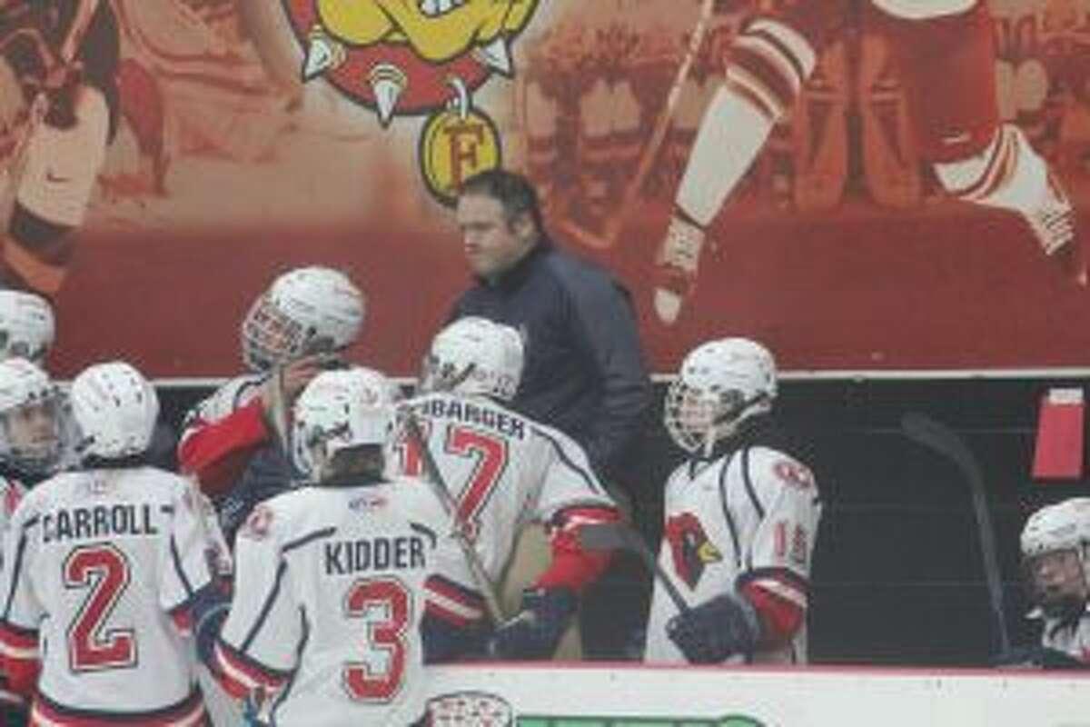 Tim Blashill and Big Rapids' hockey team celebrated a Saturday win.