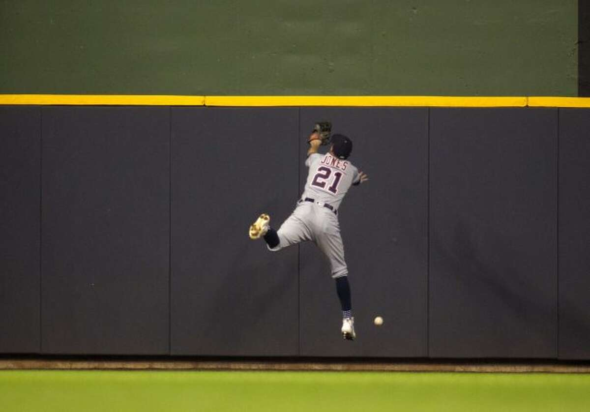 Detroit Tigers left fielder JaCoby Jones can not catch a fly ball hit from Milwaukee Brewers center fielder Lorenzo Cain during the seventh inning of an baseball game Sunday, Sept. 30, 2018, in Milwaukee. (AP Photo/Darren Hauck)