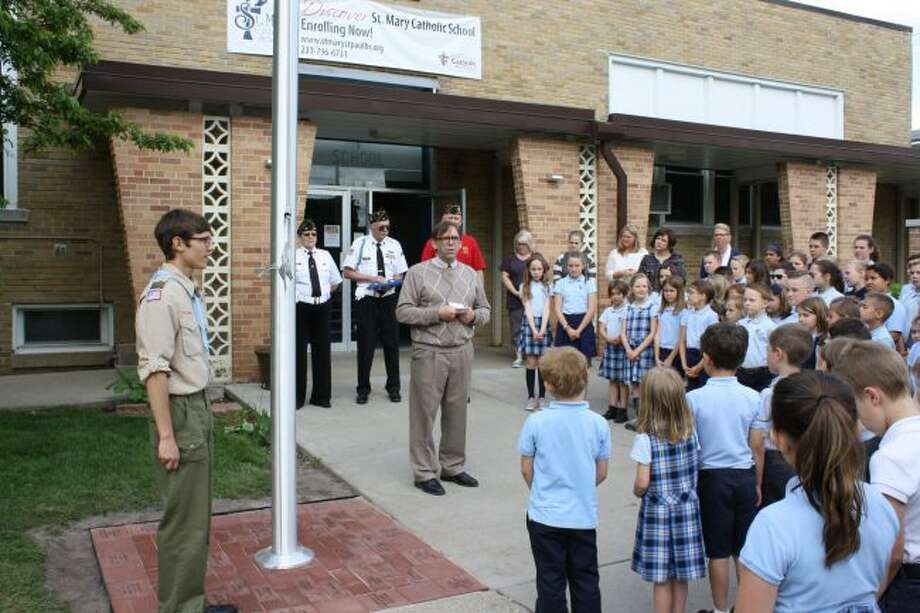 St. Mary Catholic School Principal J.B. Watters addresses the student body before a ceremony to commemorate the school's new flagpole in May. St. Mary is part of the Diocese of Grand Rapids, which has reported three consecutive years of enrollment growth among schools in the diocese. (Pioneer file photo)