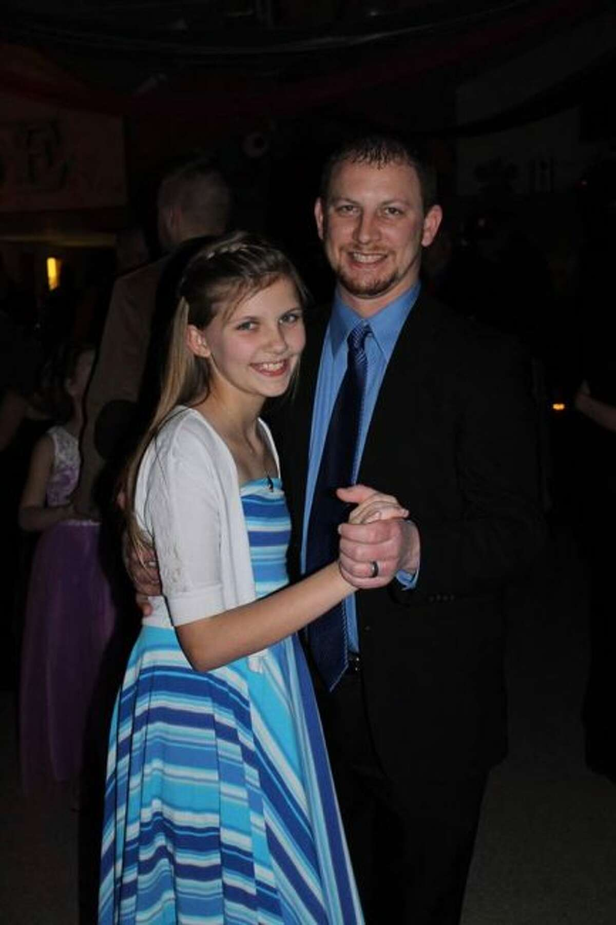 Pictured are fifth-grader Kayla Ford, and her father, Nathan Ford, at the Morley Stanwood Community Schools' daddy daughter dance, held last month. A number of other area school districts are holding dances in February. (Courtesy photo)