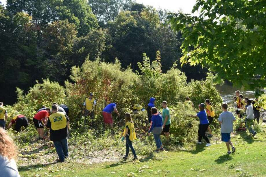 More than 150 volunteers helped clear low tree limbs and brush from the edge of the Muskegon River. (Courtesy photo)
