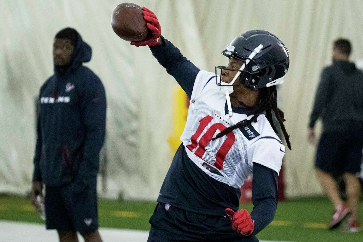 Houston Texans wide receiver DeAndre Hopkins (10) makes a one-handed catch during training camp at the Methodist Training Center on Friday, July 26, 2019, in Houston.