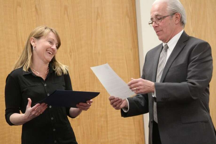 Big Rapids Mayor Tom Hogenson (right) presents a certification of appreciation to Carrie Weis Stermer during Monday's city commission meeting, recognizing her contributions to the Monarch Initiative at Clay Cliffs Nature Park for the milkweed planting initiative. The effort earned Weis Stermer recognition as the city's Parks and Recreation Person of the Year. (Pioneer photo/Brandon Fountain)