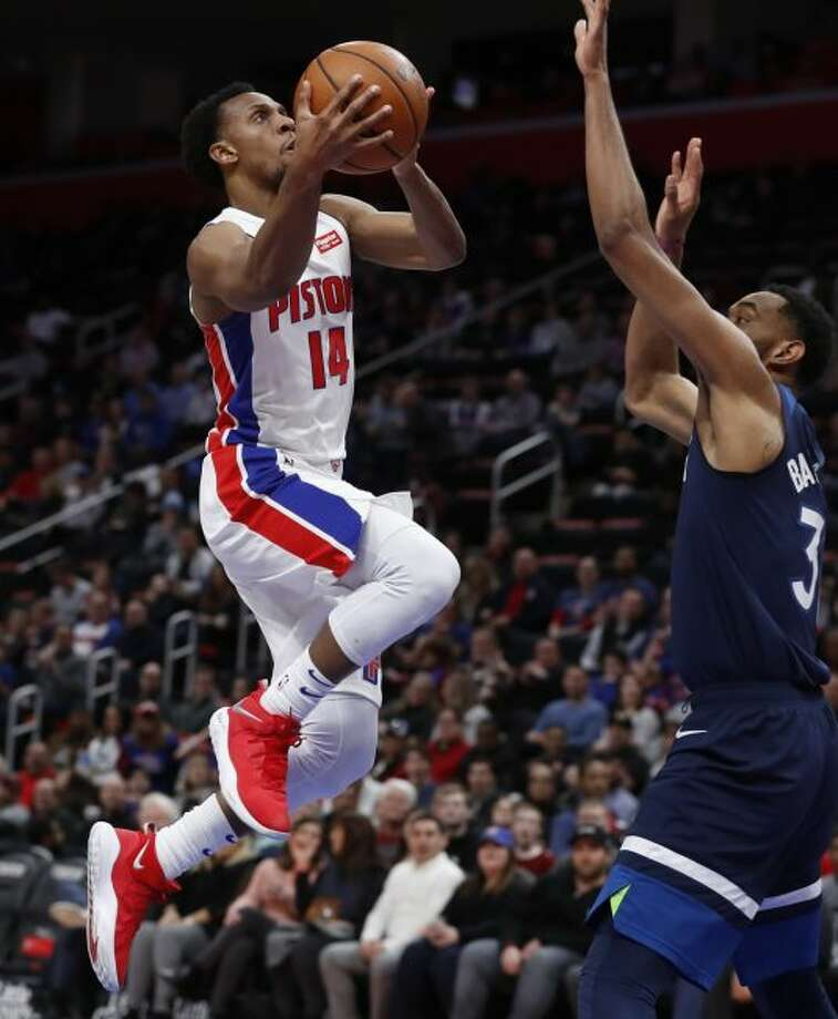 Detroit Pistons guard Ish Smith (14) shoots as Minnesota Timberwolves forward Keita Bates-Diop (31) defends during the first half of an NBA basketball game, Wednesday, March 6, 2019, in Detroit. (AP Photo/Carlos Osorio)