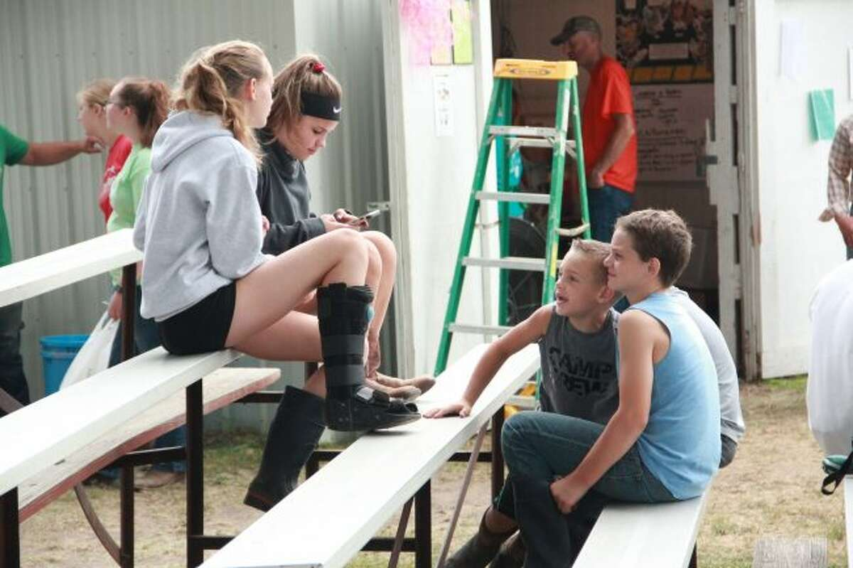 Kids spent their morning outside at the Osceola 4-H FFA Fair. At this fair, kids hung out with their friends while parents and relatives cheered on 4-H kids participating in various events including the small animal market, rabbit showmanship and poultry poster demonstrations. (Pioneer photo/Alicia Jaimes)