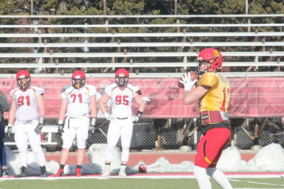 Ferris quarterback Travis Russell (17) looks for a receiver during Friday's spring football game at Top Taggart Field (Pioneer photo/John Raffel)