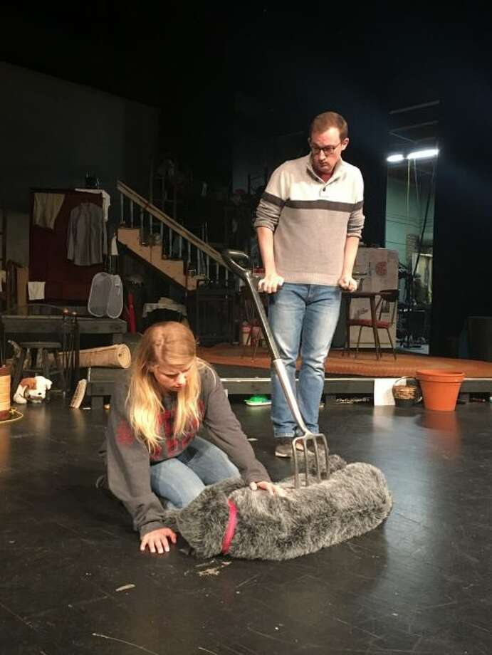 "Actors in the Ferris State University Theater production of ""The Curious Incident of the Dog in the Night-Time"" rehearse a scene at Williams Auditorium Tuesday. Pictured from left are Alyssa Bohan and Sam McNeil. (Pioneer photo/Tim Rath)"