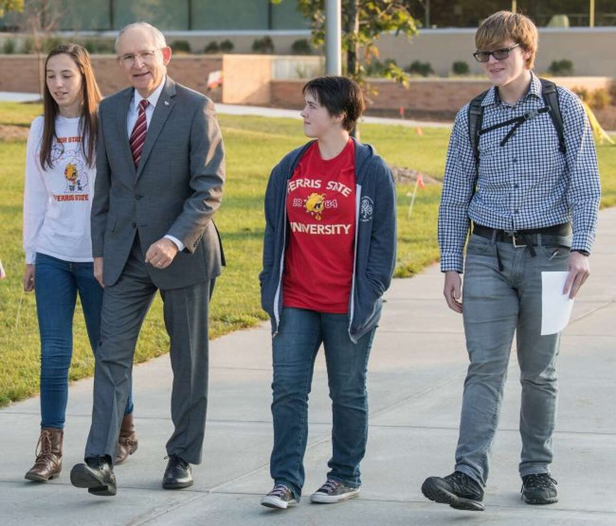 In a previous stroll across Ferris State University campus, President David Eisler (second from left) spoke with students. According to Eisler, there are more freshmen on campus this year and the student retention rate has increased. (Courtesy photo)