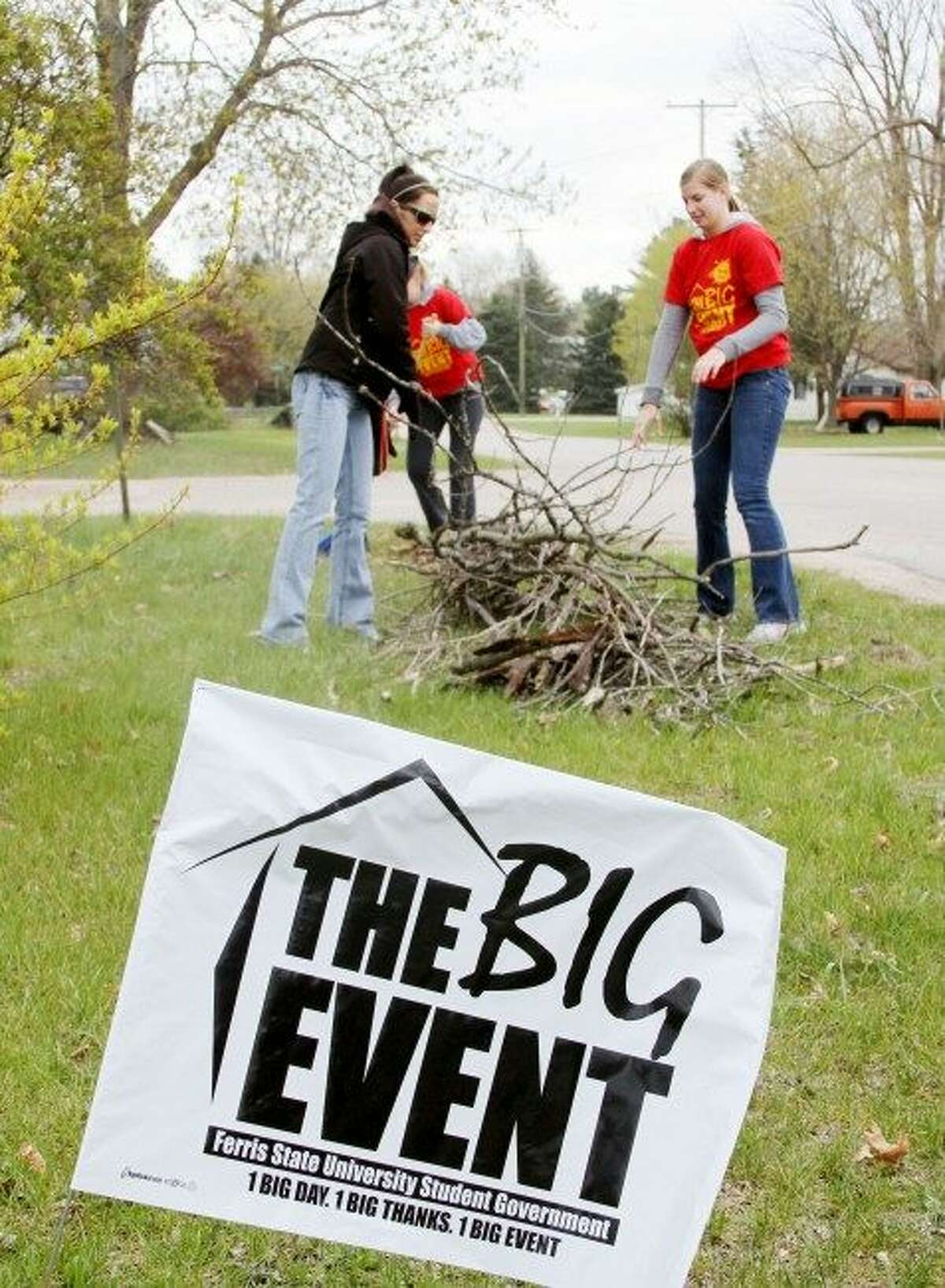 Volunteers, who are not identified, are pictured participating in The Big Event, put on by Ferris State University. (Pioneer file photo)