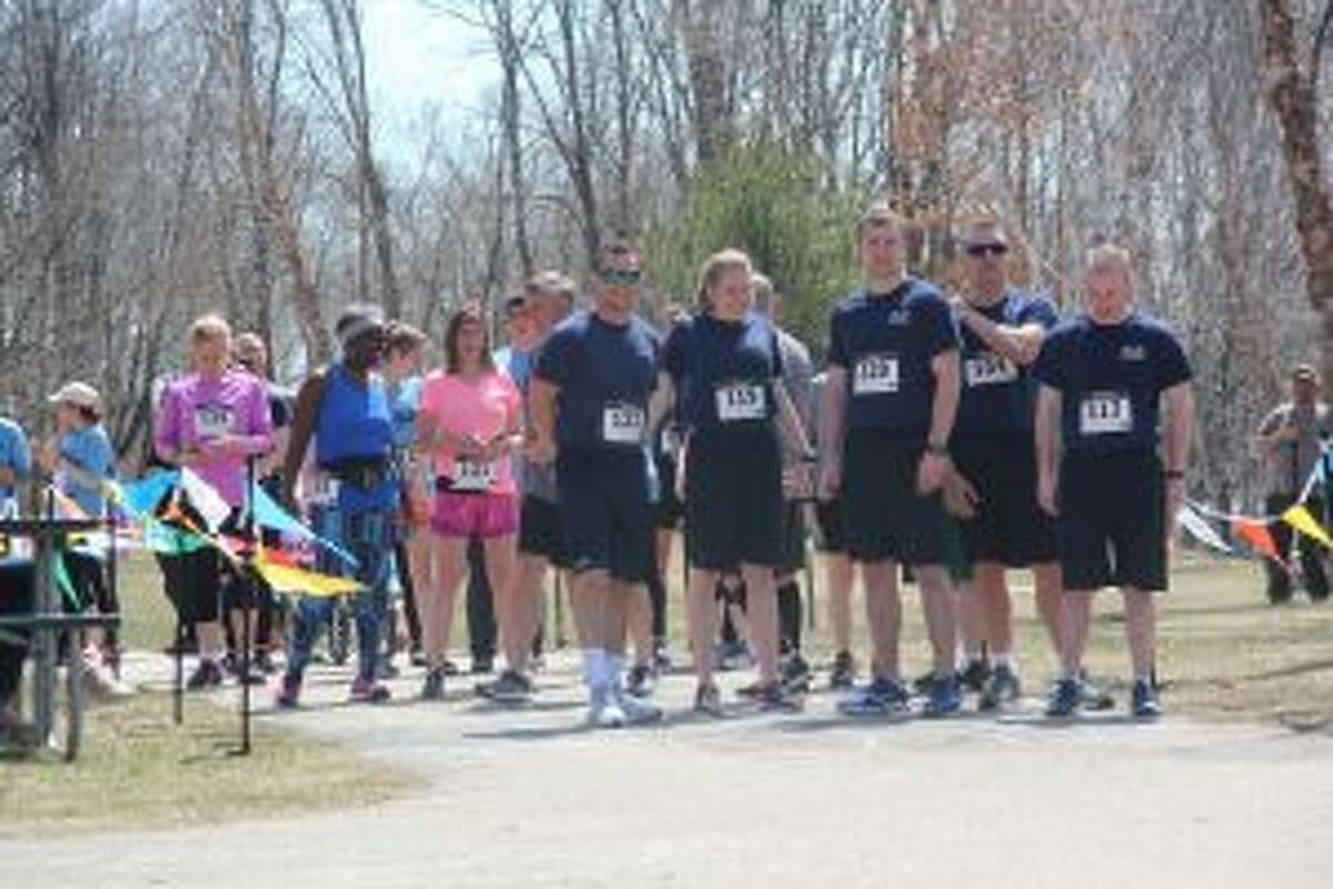 Following a short memorial service, participants in the Fallen Officer's 5K Run/Walk on Sunday afternoon get ready for run. The annual event raises funds for the Jessica Nagle Scholarship Fund, given to a Ferris State University criminal justice program student each year. (Pioneer photo/Brandon Fountain)