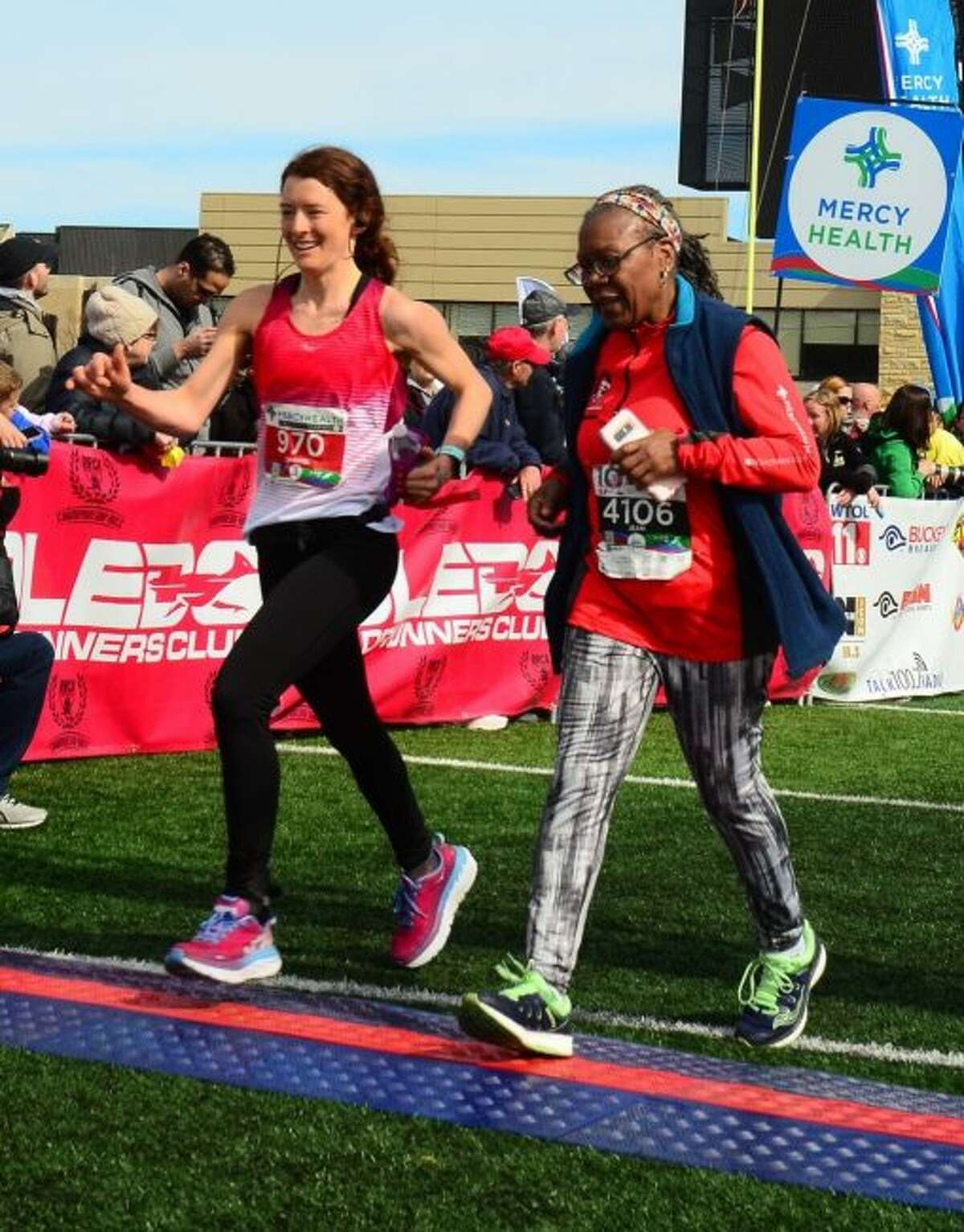 At left, Chantel Wright, 30, of Stanwood, is pictured running in the 2018 Mercy Health Glass City Marathon in Toledo, Ohio. Wright's time at the event qualified for the Boston Marathon, which she will run in on Monday. (Courtesy photo)