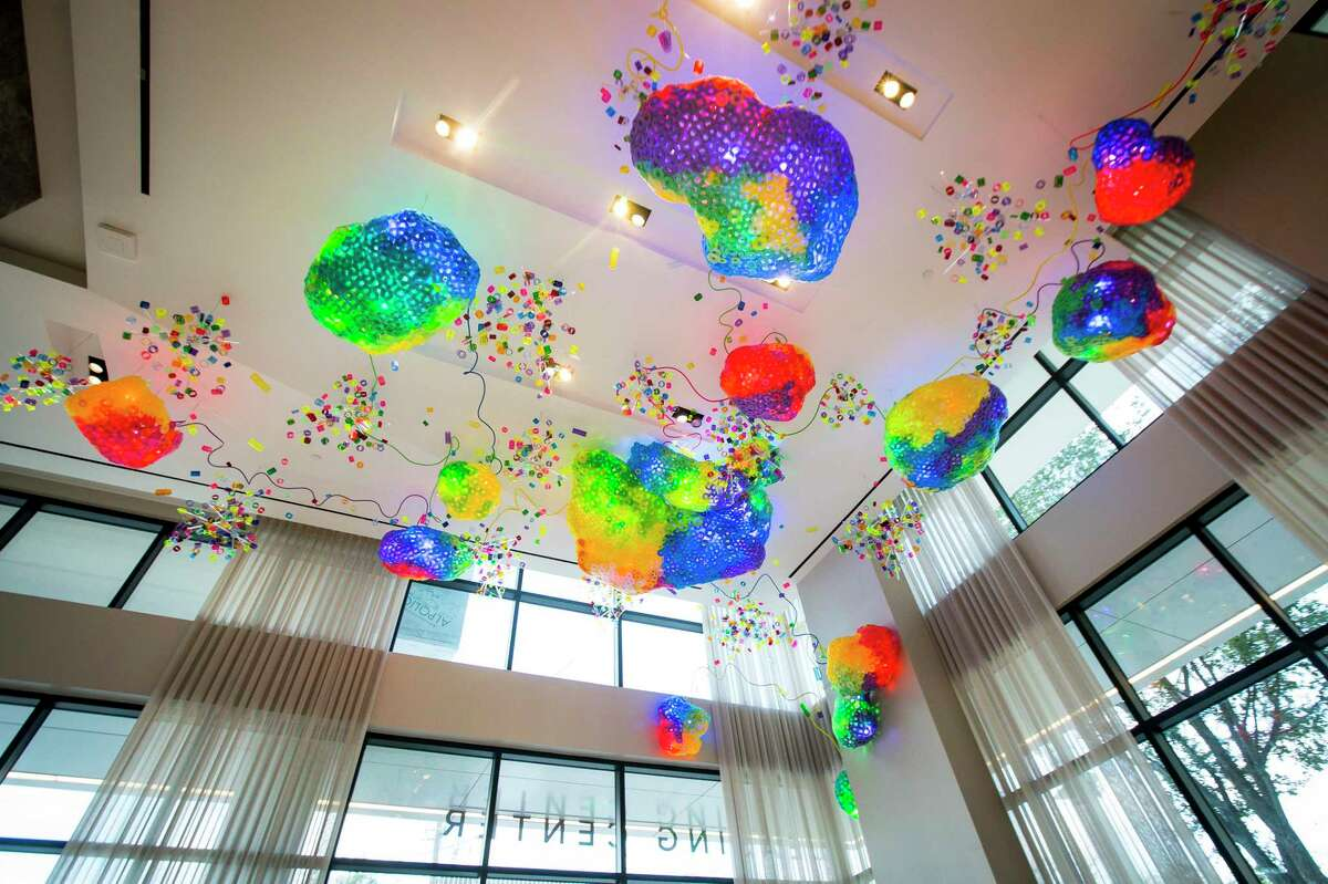 """Adela Andea's """"The Great Barrier Reef"""" hangs from the lobby ceiling at the new Drewery Place luxury high-rise in midtown Houston, Tuesday, July 2, 2019."""