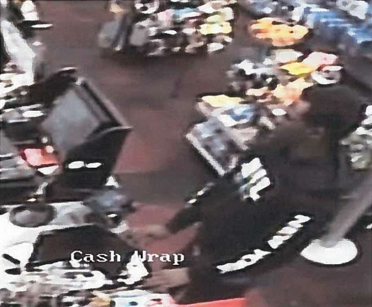 A second man who is suspected of passing counterfeit $100 bills in Big Rapids on Wednesday night is seen in this photo from video footage from a local business. Big Rapids police are searching for the identities of the two men. (Courtesy photo)