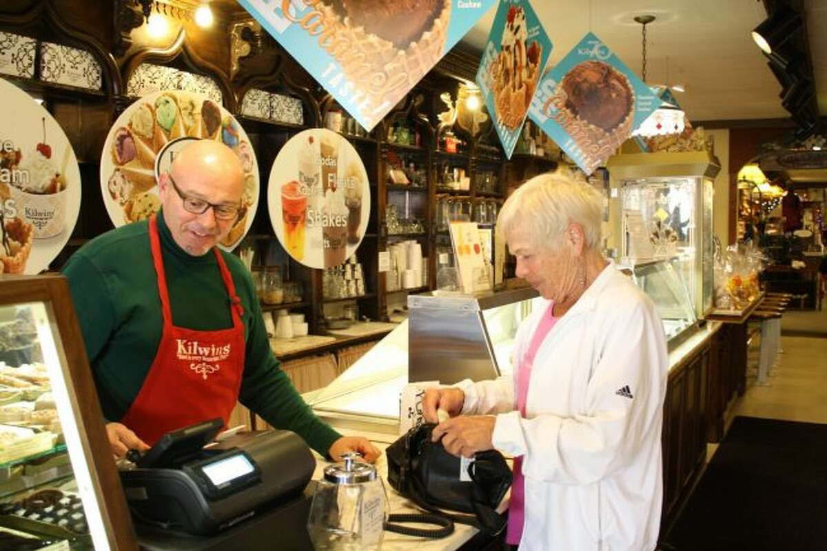 Old Pioneer Store and Emporium owner Brian Rose chats with Judy Cook as she completes her purchase on Monday morning. (Pioneer photo/Candy Allan)
