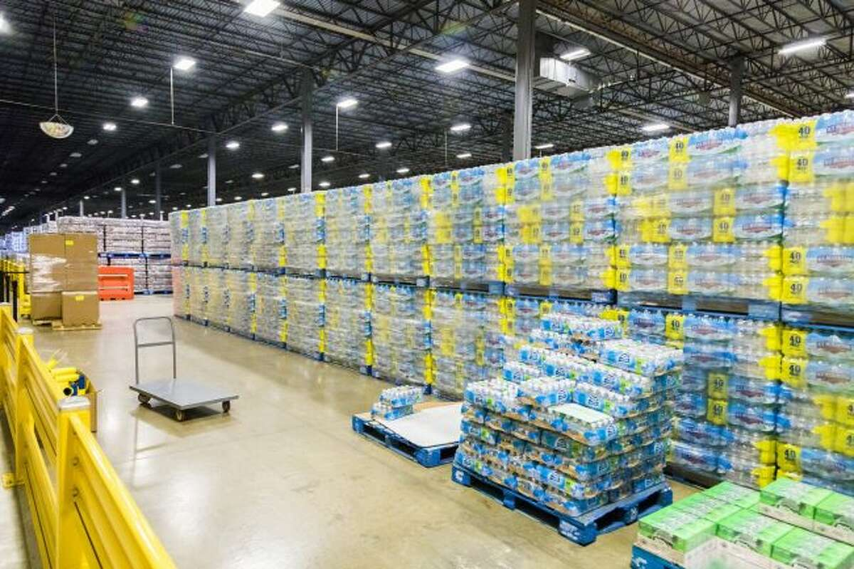 In this file photo, hundreds of packages of Ice Mountain spring water is shown in the Ice Mountain Natural Spring Water facility in Stanwood. On Monday, local law enforcement officials responded to a report of appoximately 40 protesters trying to gain access to the facility. (Pioneer file photo)