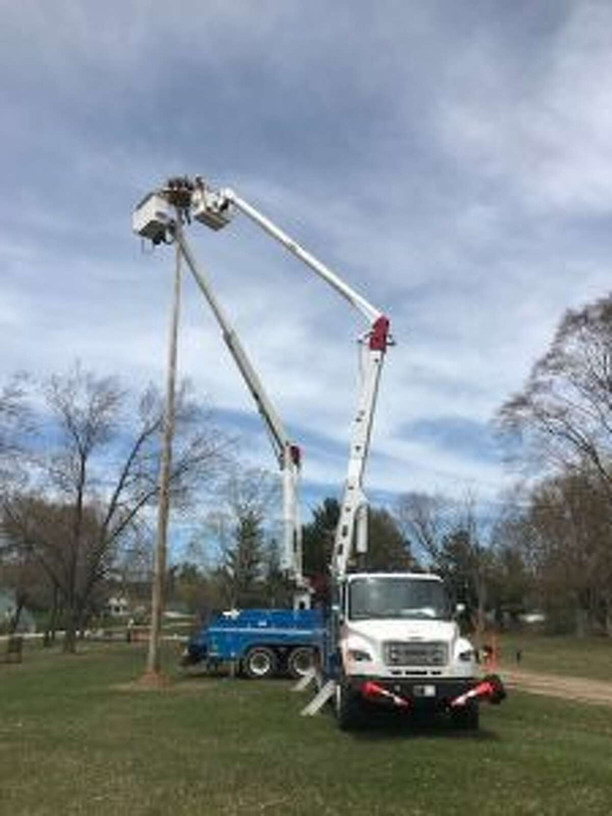 Consumers Energy helped the Mecosta County Parks Commission with moving the osprey nest to a safer place. The platform on the pole was constructed and donated by the local Cub Scout troop. (Courtesy photo)