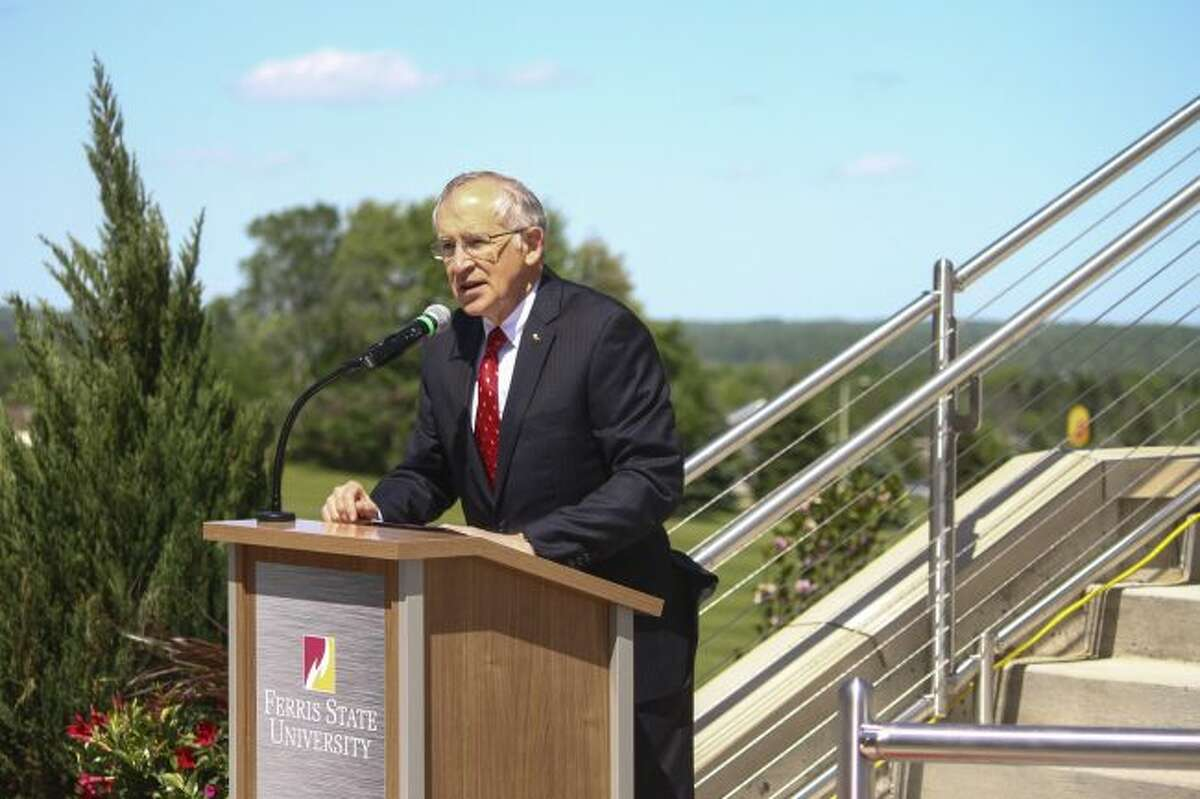 Ferris State University president David L. Eisler speaks during the grand opening celebration of the Ken Janke Sr. Golf Learning Center and Michigan Golf Hall of Fame Saturday at the Janke Learning Center entrance. (Pioneer photo/Maxwell Harden)