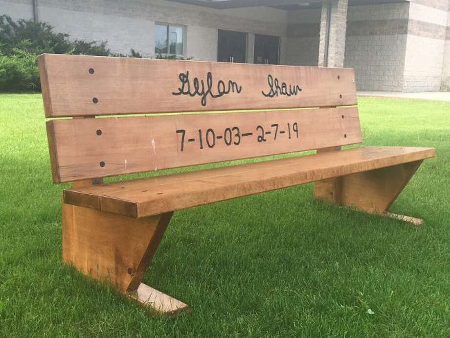 A bench, engraved with the signature of the late Dylan Shaw, was recently placed outside Evart High School. Shaw died after falling into the Muskegon River in February. (Pioneer photo/Tim Rath)