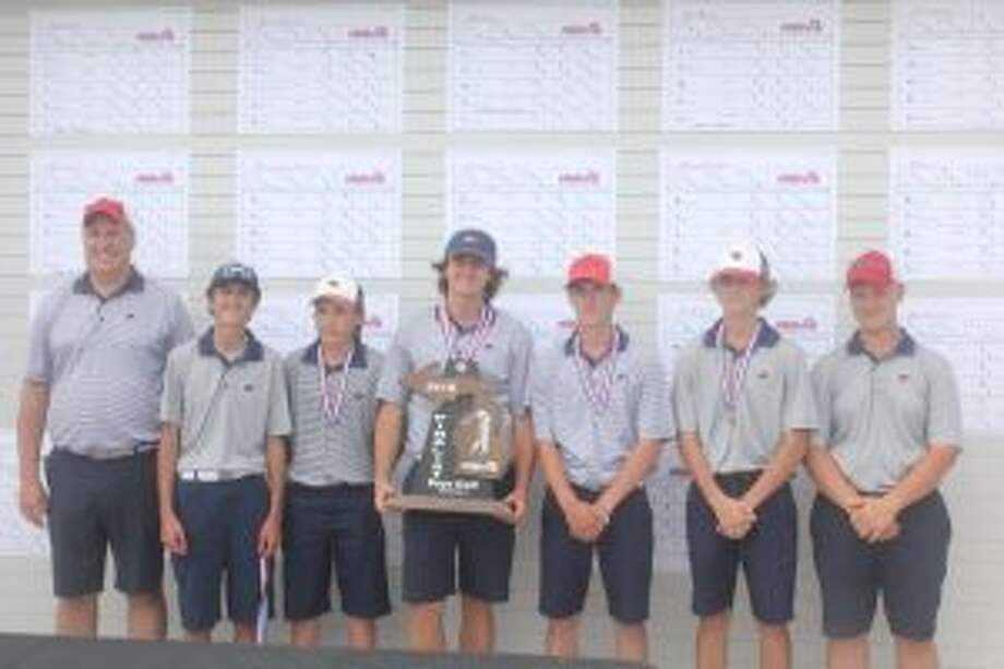 Big Rapids' golf team poses with the state runner-up trophy: from left, coach Mark Posey, Brett Lilienthal, Luke Welch, Pierce Morrissey, Owen Seay, Trevor Woodard and Dawson Currie. (Pioneer photo/John Raffel)