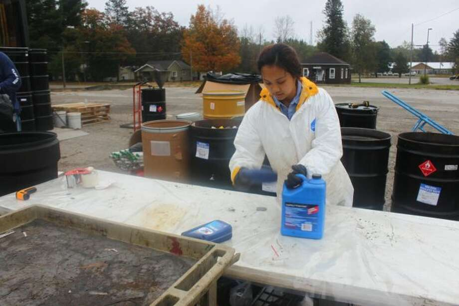 Officials collect chemicals for vehicles during the annual Clean Sweep and Household Hazaroud Waste disposal day in 2017. This year's collection will be from 9 a.m. to noon on Saturday, Oct. 13, in locations in Mecosta, Lake and Osceola counties. (Pioneer file photo)