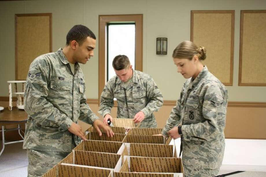 (From left) Airman 1st Class Ante Webb, Airman 1st Class Jacob Mitchell and Airman Marisa Sees help pack boxes during the 2017 Jerky for the Troops event. (Pioneer file photo)