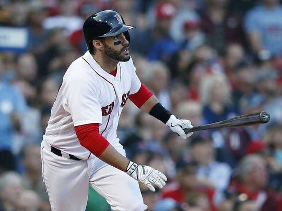Boston Red Sox's J.D. Martinez watches his three-run home run during the fourth inning of a baseball game against the New York Yankees in Boston, Sunday, Sept. 30, 2018. (AP Photo/Michael Dwyer) (Photo: The Associated Press)