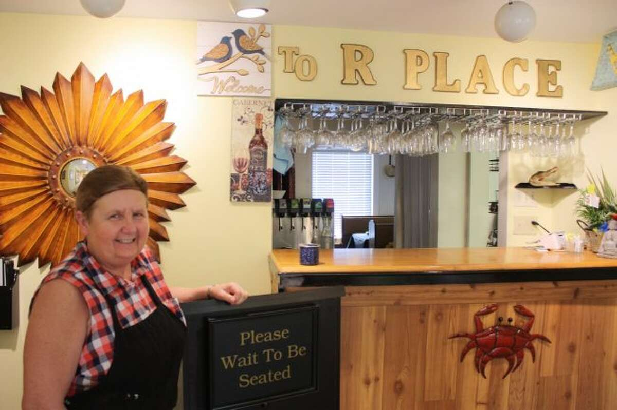 Mary Challender Smith, owner of R Place restaurant in Big Rapids, is pictured Monday. Smith also owns Alamode Cafe in Big Rapids. (Pioneer photo/Tim Rath)