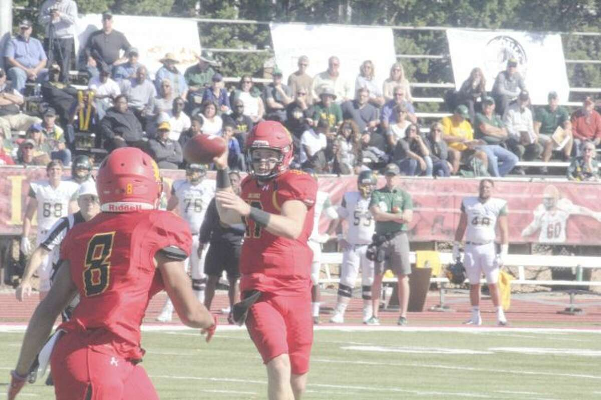 Ferris quarterback Travis Russell looks for a receiver against Wayne State. (Pioneer photo/John Raffel)