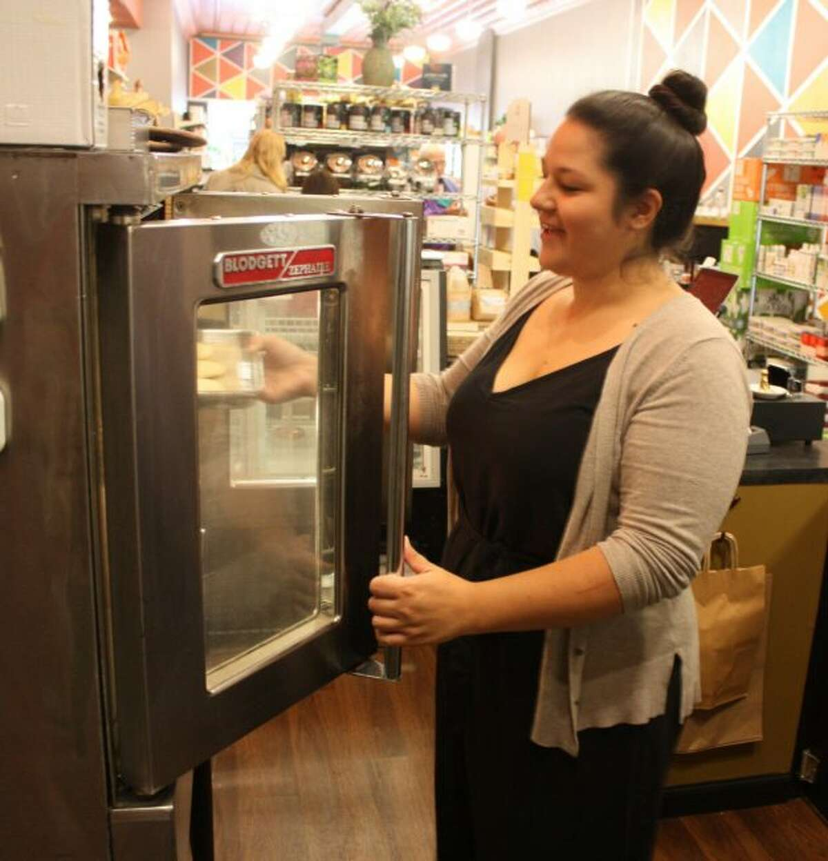 Nicole Martinez, who opened the Coco Renee bakery in Big Rapids earlier this month, is pictured Thursday. (Pioneer photo/Tim Rath)