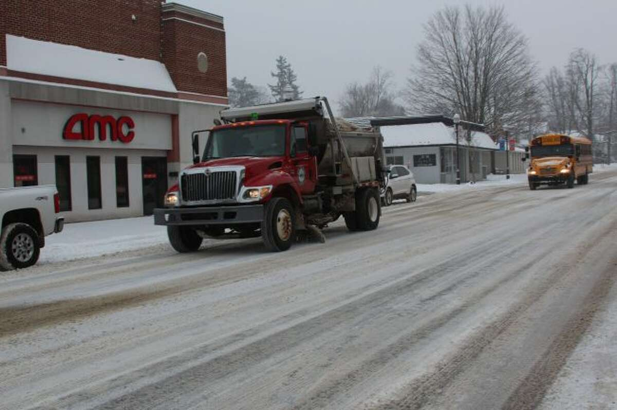 A Big Rapids plow removes snow from Michigan Avenue Wednesday morning. More than five inches of snow fell on the area, and crews were out throughout Mecosta and Osceola counties. (Pioneer photo/Brandon Fountain)