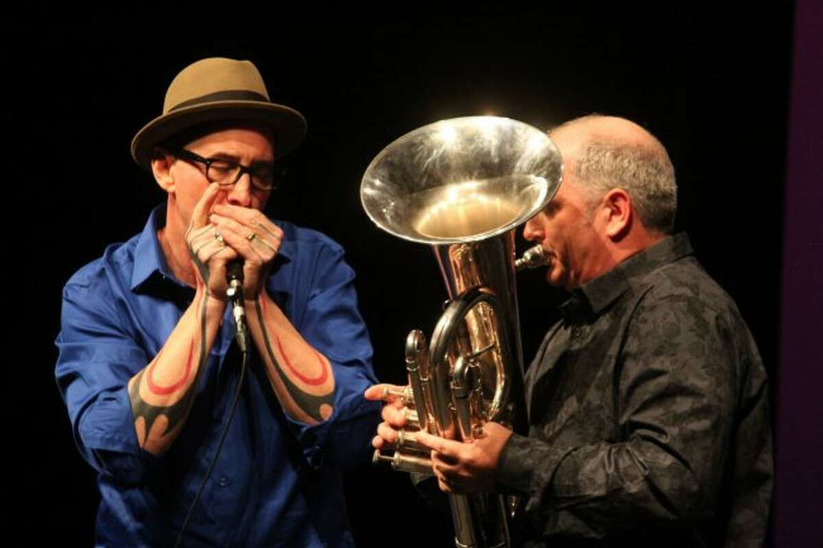 Jeff Getty (not seen), Mike Stevens and Ed Mallett play during Saturday's Tuba Bach New World Exploration series concert Saturday night at Big Rapids High School Auditorium. Along with playing music, Stevens shared some