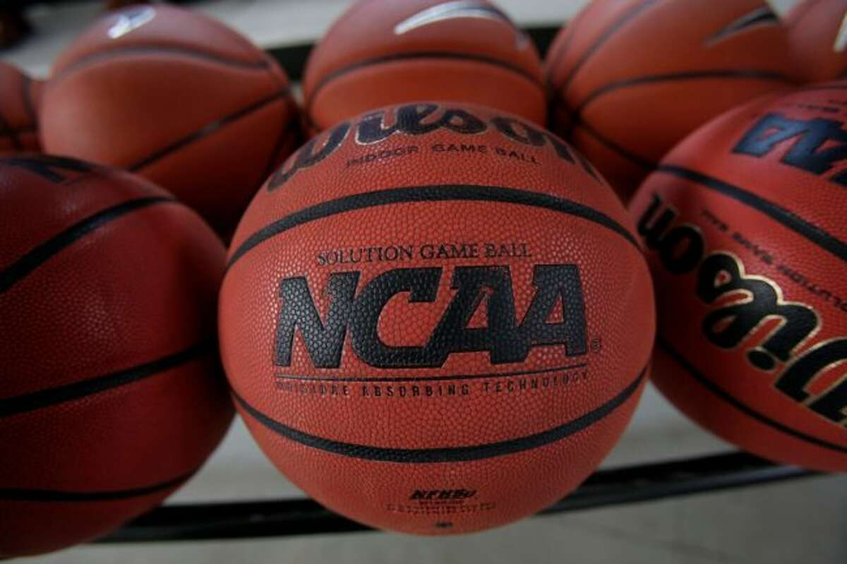 In this March 22, 2010, file photo, basketballs are seen before Northern Iowa's NCAA college basketball practice, in Cedar Falls, Iowa. College basketball spent an entire season operating amid a federal corruption investigation that magnified long-simmering problems within the sport, from unethical agent conduct to concerns over the