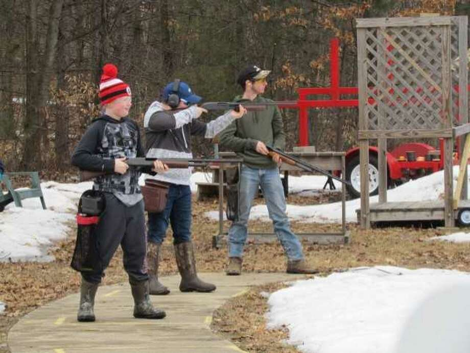Preston Younge, Kyle Colin and Denver Hayes, members of the Big Rapids Trap Shooting Team, practice at the Mecosta Rod and Gun Club for upcoming league competition. This is the first year Big Rapids Public Schools has put together a team to participate in the league. (Courtesy photo)