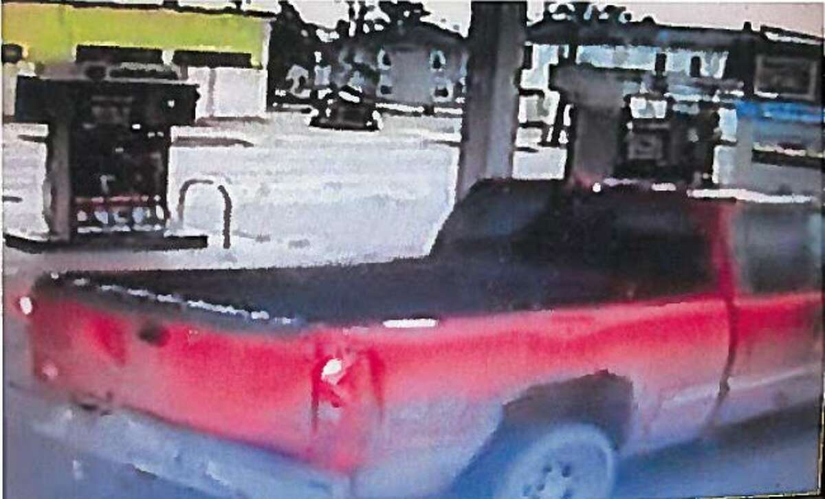The man suspected of stealing a trailer with scrap metal inside is driving this early-2000s model GMC Sierra, seen here in surveillance footage. (Courtesy photo)